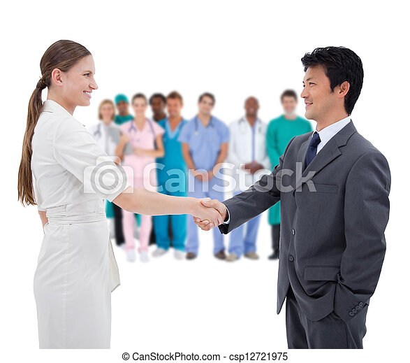 Business people shaking hands with  - csp12721975