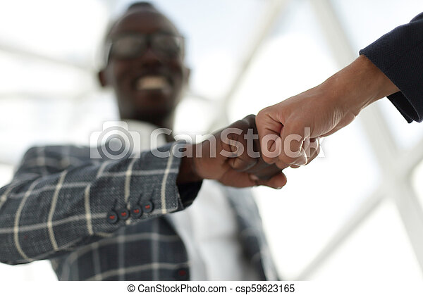 Business people showing Fist Bump after meeting - csp59623165