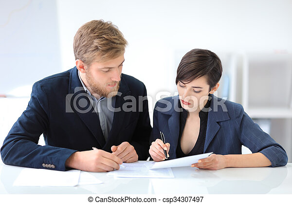Business people signing a contract - csp34307497