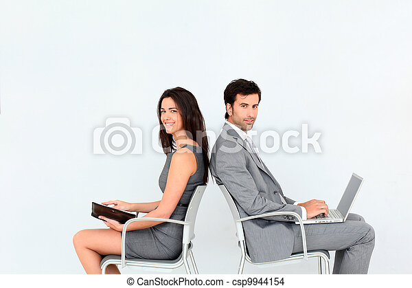 Business people sitting in chairs back to back - csp9944154
