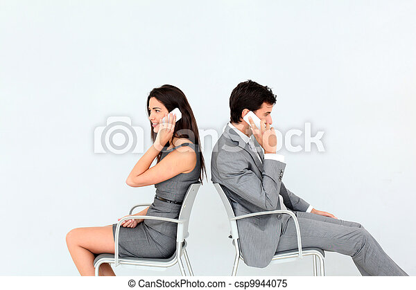Business people sitting in chairs with mobile phone - csp9944075