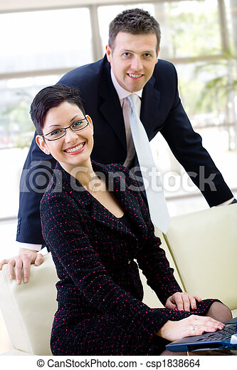 Business people smiling - csp1838664