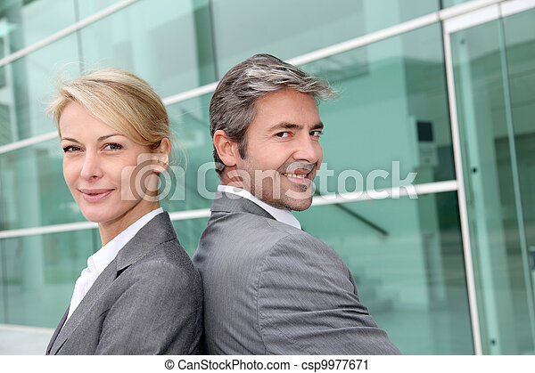 Business people standing back to back - csp9977671