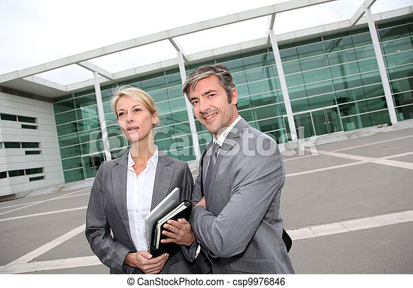 Business people standing in front of exhibition building - csp9976846
