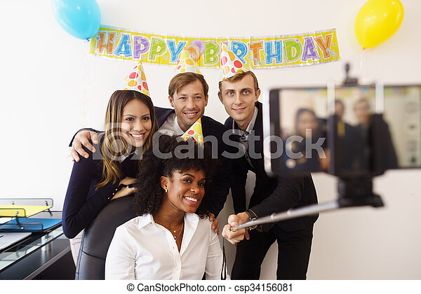 Business People Taking Selfie With Phone At Office Party  - csp34156081