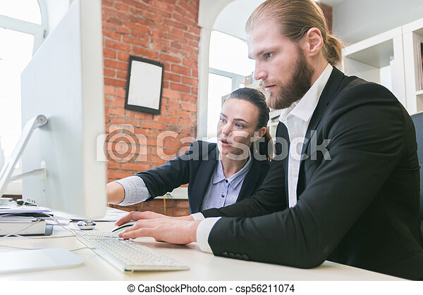Business people using computer in office - csp56211074