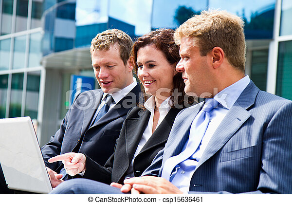 business people with tablet computer signing contract on a  bench  - csp15636461