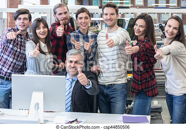 Business people with thumbs up - csp44850506
