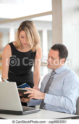 Business people working in the office - csp9953551