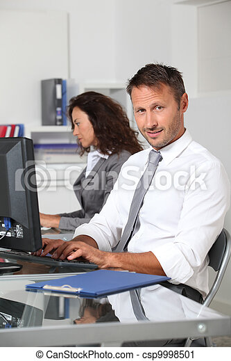 Business people working in the office - csp9998501