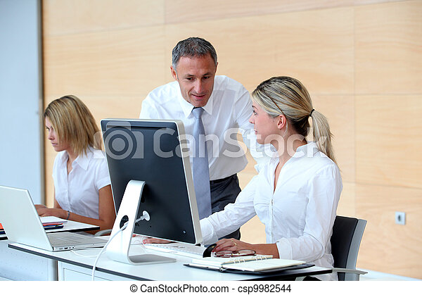Business people working in the office - csp9982544