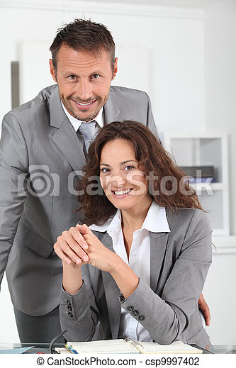 Business people working in the office - csp9997402