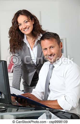 Business people working in the office - csp9998109