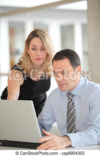 Business people working in the office - csp9954303