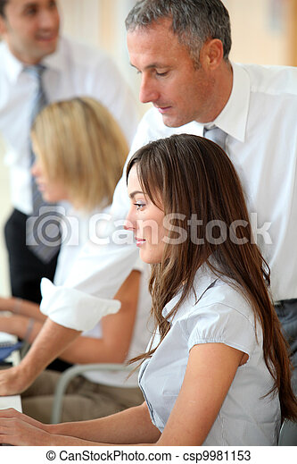 Business people working in the office - csp9981153