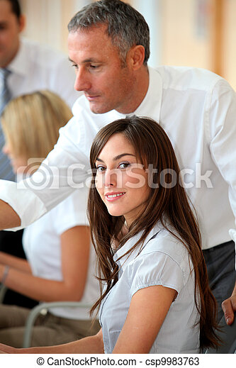 Business people working in the office - csp9983763