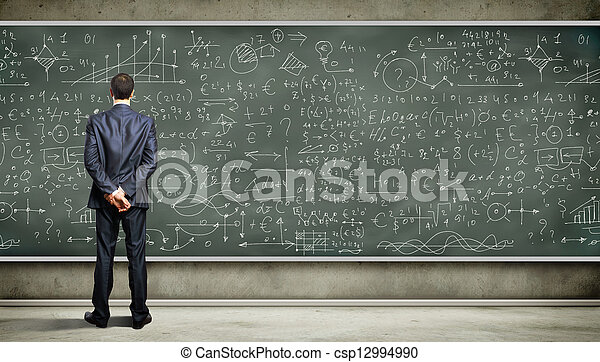Business person against the blackboard - csp12994990
