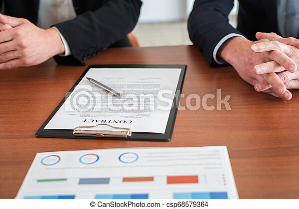 Business Person Signing Contract - csp68579364