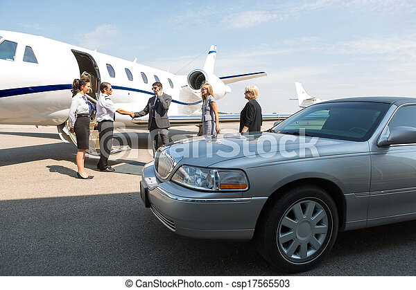 Business Professional Greeting Airhostess And Pilot - csp17565503