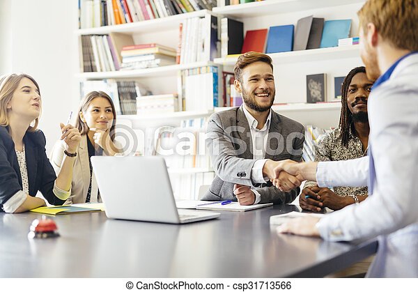 Business shaking hand with a client - csp31713566