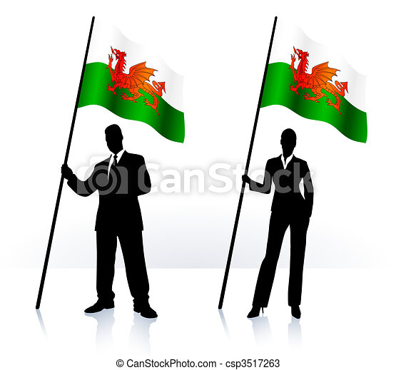 Business silhouettes with waving flag of Wales - csp3517263