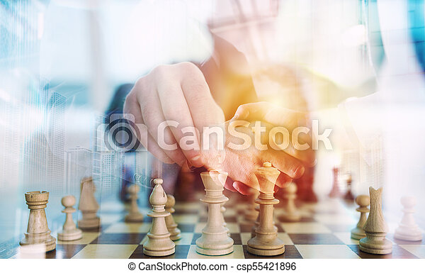 Business strategy with chess game and handshaking business person in office. concept of challenge and tactic. double exposure - csp55421896