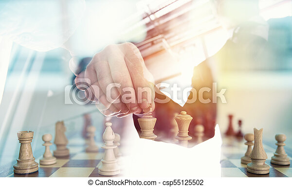 Business strategy with chess game and handshaking business person in office. concept of challenge and tactic. double exposure - csp55125502