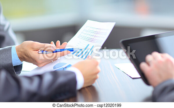 Business team analyzing market research results together - csp12020199