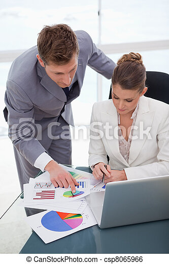 Business team  analyzing survey results - csp8065966