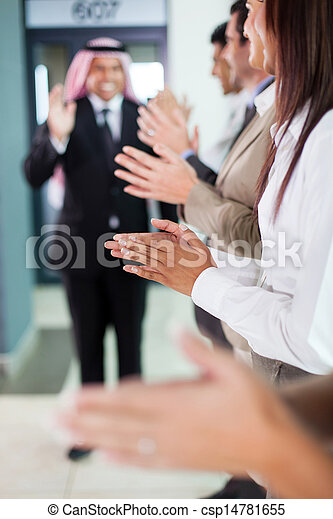 business team applauding to welcome arabian businessman - csp14781655