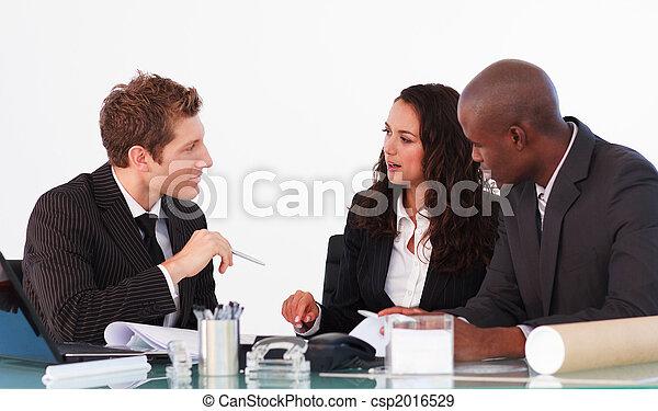 Business team conversing in a meeting - csp2016529