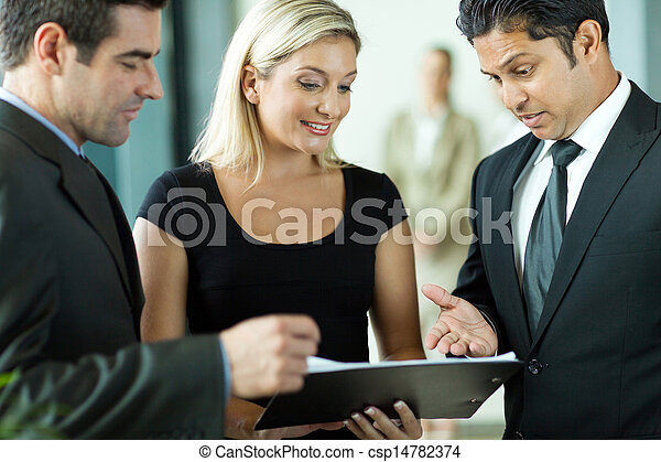 business team discussing a contract - csp14782374