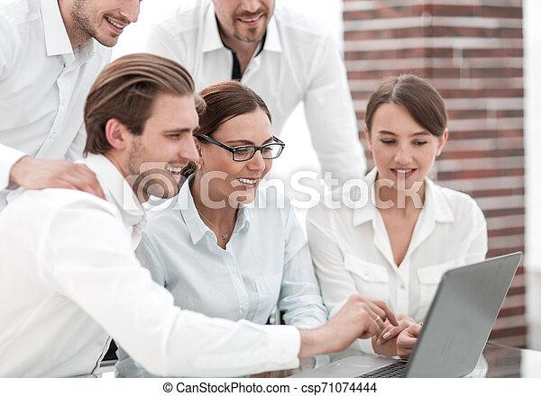 business team discussing online news - csp71074444