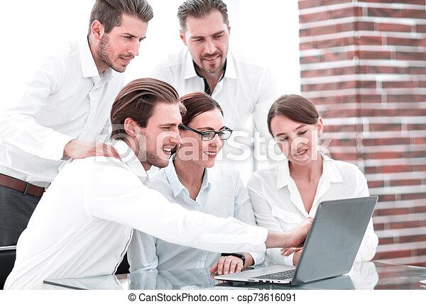 business team discussing online news - csp73616091