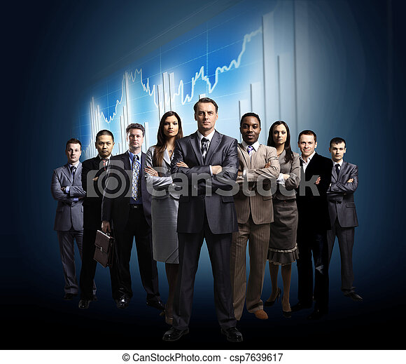 business team formed of young businessmen standing over a dark background  - csp7639617