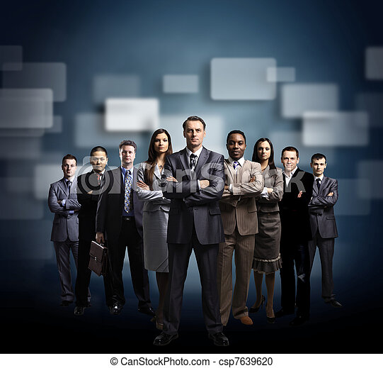 business team formed of young businessmen standing over a dark background  - csp7639620