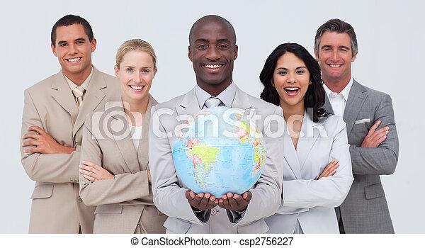 Business team holding a terrestrial globe - csp2756227