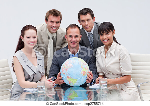 Business team holding a terrestrial globe. Global business - csp2755714