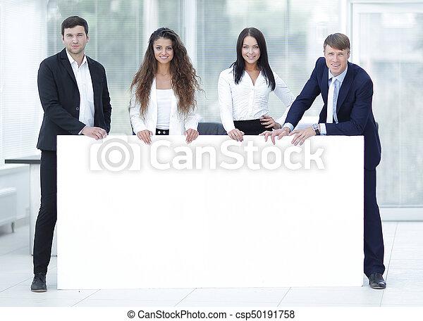 business team holding blank white banner - csp50191758