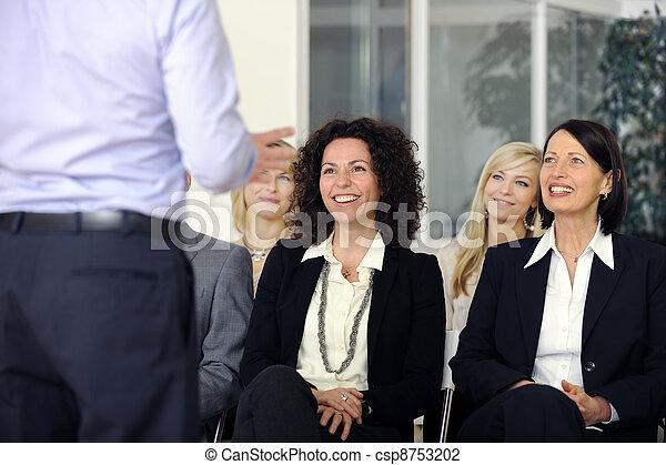 Business team listening smiling to speaker - csp8753202
