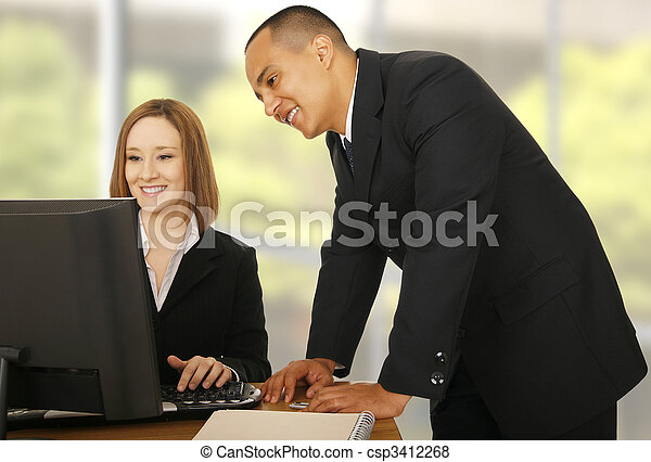 Business Team Looking At Compiter - csp3412268