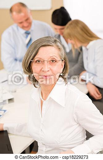 Business team meeting executive senior woman - csp18229273