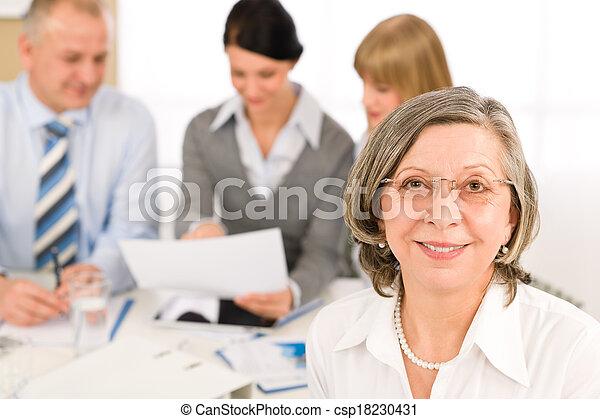Business team meeting executive senior woman - csp18230431