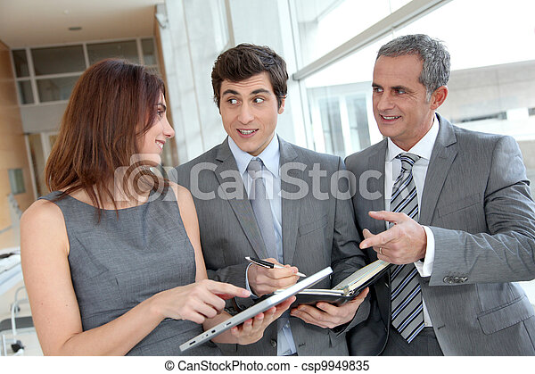 Business team meeting in hall - csp9949835