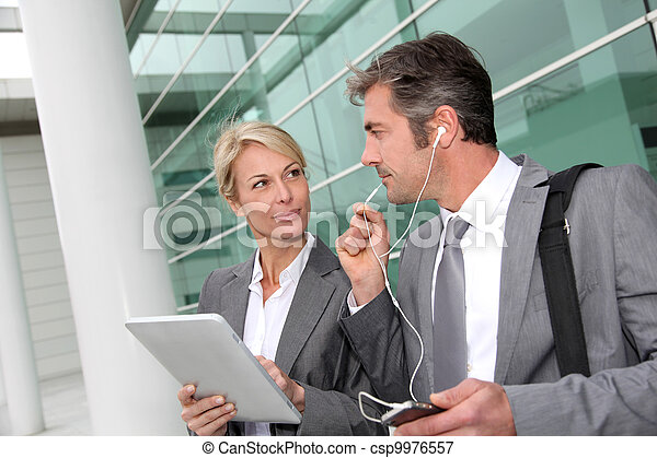 Business team meeting outside with tablet - csp9976557