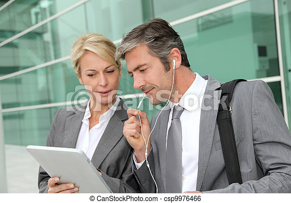 Business team meeting outside with tablet - csp9976466