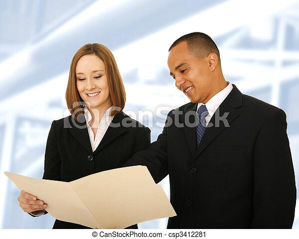 Business Team Reviewing Folder - csp3412281