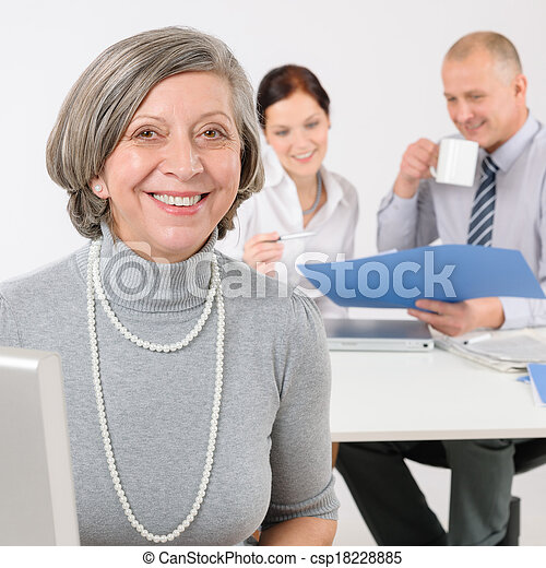 Business team senior manager woman with colleagues - csp18228885
