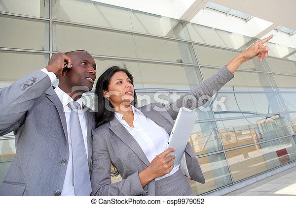 Business team standing outside congress center - csp9979052