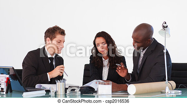 Business team talking to each other in a meeting - csp2016536